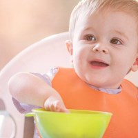 How do I move my baby onto proper meals?